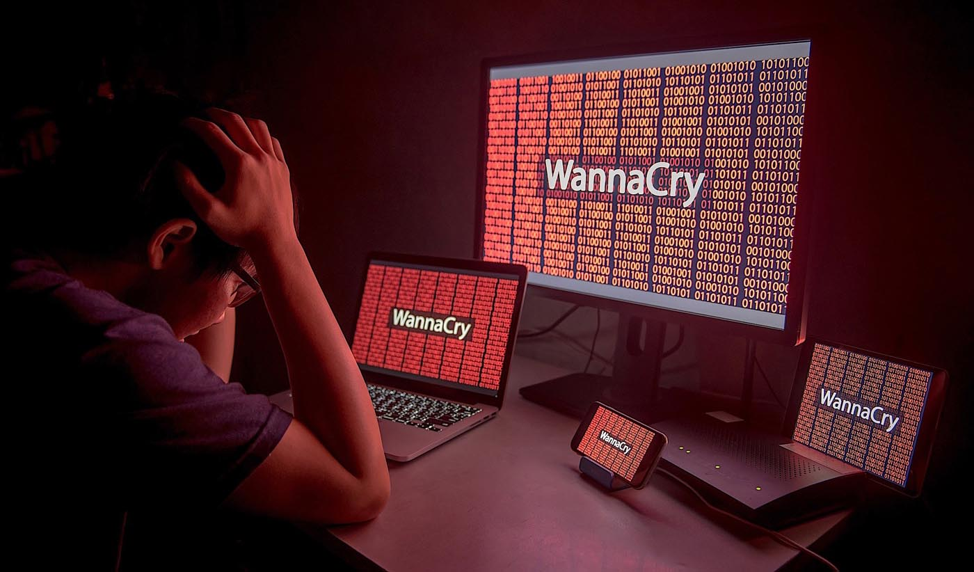 Young Asian male confused and headache by WannaCry ransomware attack